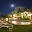 Beautiful hotel in mountain village with swimming pool at night. Panoramic photo. Montejaque. Malaga. Andalusia. Spain. — Stock Photo