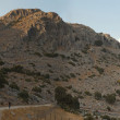 Beautiful panoramic photo of the amazing rocky mountain landscape of Sierra de Grazalema Natural Park at sunset. Rocks and pine trees. Blue sky. Andalusia. Spain. — Stock Photo