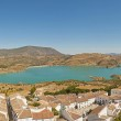 Panoramic landscape photo of Sierra de Grazalema national park. Old village with white houses. Pueblos blancos. Beautiful scenery. Blue sky. Malaga. Andalusia. Spain. — Stock Photo #13131042