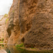 Panoramic photo at the bottom of the canyon of the Guadalevin river. Water mine of the House of the Moorish King. Casa dl Rey Moro. Spanish city Ronda. Malaga. Andalusia. — Stock Photo #13131375