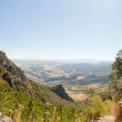 Panoramic landscape photo of Sierra de Grazalema national park. Female tourist taking pictures of the amazing landscape. Beautiful scenery. Blue sky. Malaga. Andalusia. Spain. — Stock Photo #13131405