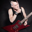 Punk rock man with red electric guitar and mohawk haircut. Expressive face. Isolated on black background. Studio shot. — Stock Photo