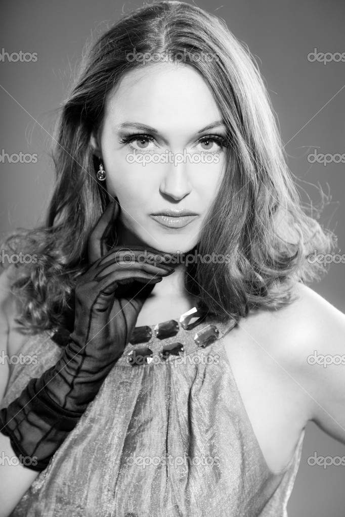 Glamour black and white portrait of pretty woman with long hair. Studio portrait isolated on grey. — Stock Photo #13218441