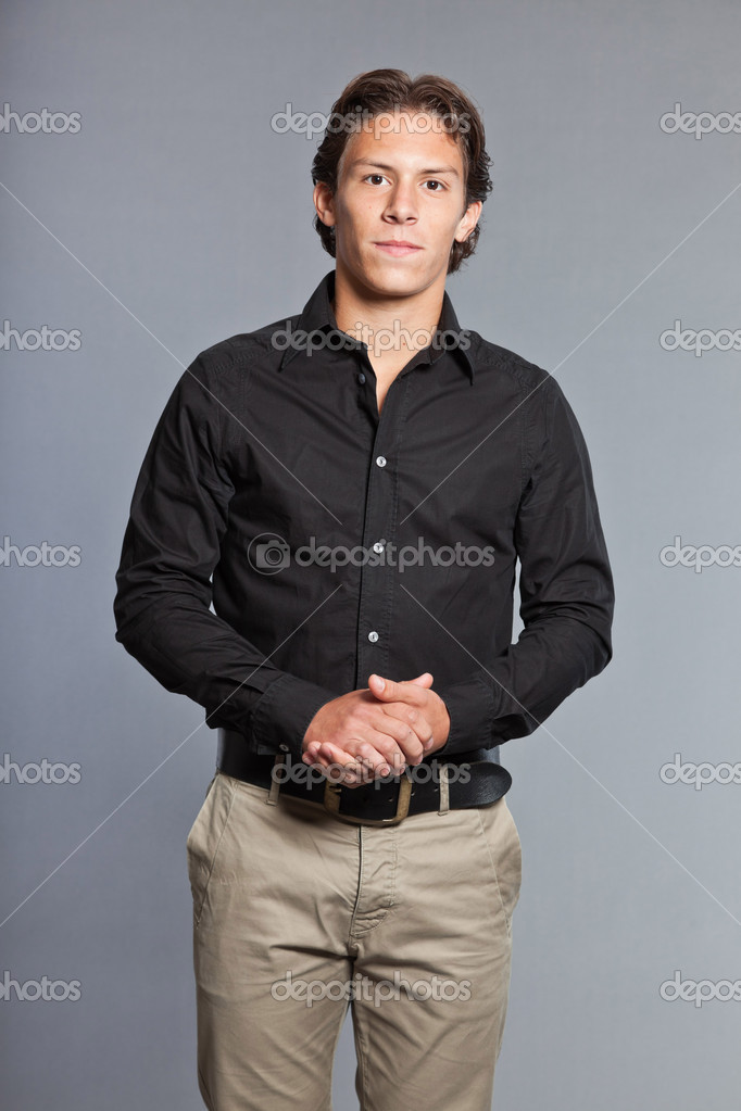 depositphotos_13434791-Teenage-boy-with-brown-hair-and-eyes.-Wearing-black-shirt-and-khaki-pants.-Good-looking.-Casual-wear.-Expressions.-Studio-portrait- ...