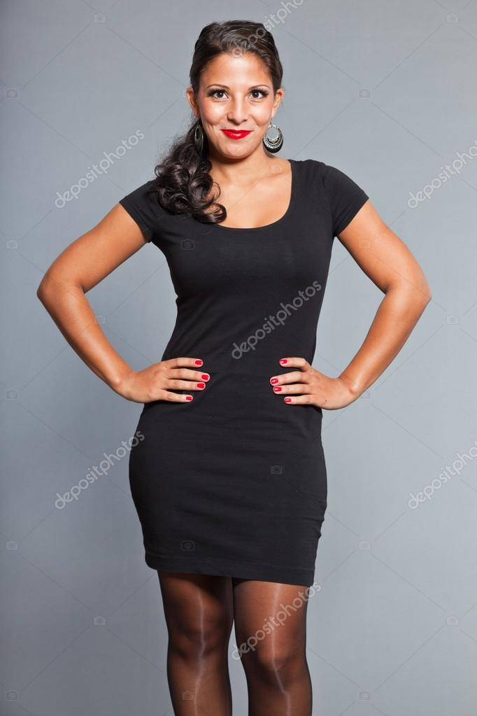 Hair and eyes wearing black dress red lipstick and red nail polish