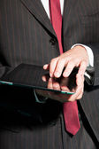Closeup of business man with tablet. — Stock Photo