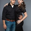 Diverse young couple together. Dressed in black. — Stock Photo