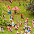 Collection of colorful dwarf figures in a garden. — Stockfoto