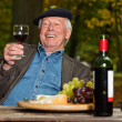 Senior french man enjoying red wine. — Stock Photo #14133598
