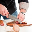 Cook cutting raw ingredients. — Stock Photo