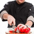 Young male cook with black jacket preparing raw ingredients. — Stock Photo