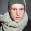 Fashion studio portrait of handsome young man against grey background. — Stock Photo