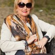 Stock Photo: Middle aged good looking woman. Urban fashion.