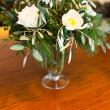 White flowers in a vase on wooden table. — Stock Photo
