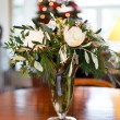 White flowers in a vase on wooden table. - Stock Photo