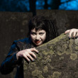 Gothic girl at cemetery. — Stock Photo