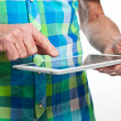 Closeup of hand from senior man using tablet. — Stock Photo