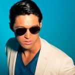 Asian man wearing suit and sunglasses. Summer fashion. Studio. — Stock Photo