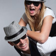 Young couple man and woman in love. Sunglasses and hat. — Stok fotoğraf