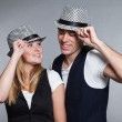 Happy young couple man and woman in love. Wearing hat. — Stok fotoğraf