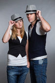 Happy young couple man and woman in love. Wearing hat. — Stock Photo