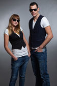 Young couple man and woman in love. Sunglasses. — Stock Photo