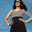 Pretty indian girl with sunglasses on the beach in summer. — Stock Photo