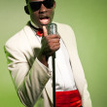Singing black american man in suit wearing sunglasses. Vintage. — Stock Photo