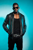 Cool urban stylish black american man. Fashion studio shot. — Stock Photo