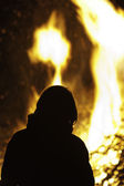 Silhouette of person in front of big campfire. — Stock Photo
