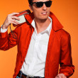 Retro fifties style man with sunglasses. Listening to radio. Reb — Stock Photo #24377413