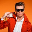 Retro fifties style man with sunglasses. Listening to radio. Reb — Stock Photo #24427301