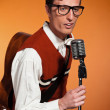 Retro fifties style rock and roll singer with vintage microphone — Stock Photo