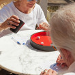 Senior couple playing dice game outdoor in garden. Yahtzee. — Stock Photo #25761373