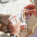 Senior man playing card game outdoor in garden. — Stock Photo