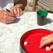 Senior couple playing dice game outdoor in garden. Yahtzee. — Stok fotoğraf