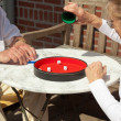 Senior couple playing dice game outdoor in garden. Yahtzee. — Zdjęcie stockowe
