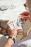 Senior man playing card game outdoor in garden. — Foto Stock