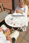 Senior couple playing card game outdoor in garden. Top view. — Foto Stock