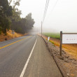 Stock Photo: Road through winery landscape with sign. NapValley, California