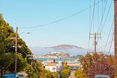 Alcatraz island seen from the city of San Francisco. Blue sky. — Stock Photo
