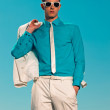 Retro fifties summer fashion man with white suit and sunglasses. — Stock Photo