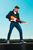 Retro 50s rockabilly electric guitar player with black leather j — Stock Photo