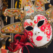 Stock Photo: Colorful traditional venetian masks at souvenir shop. Venice. It