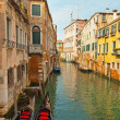 Venetian canals with houses and two gondola boats. Venice. Italy — Stock Photo