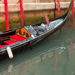 Venetian gondola boat in canal. Venice. Italy. — Stock Photo #26105219