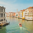Colorful canal of Venice with houses and boat. View from Rialto  — Stock Photo