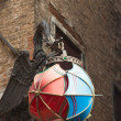 Decorative umbrella shape street lantern on corner of street in  — Stock Photo