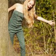Funny happy young blonde girl in green park. — Stock Photo #26712951