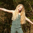 Funny happy young blonde girl in green park. — Stock Photo #26713101